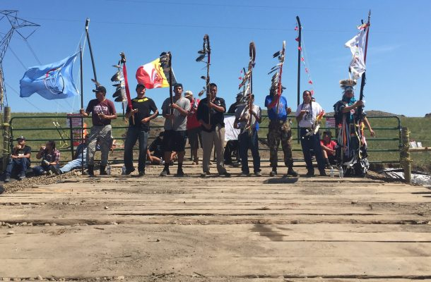 Peaceful protectors/protestors stand at the Dakota Access Pipeline construction site near Cannonball, ND, on Aug. 17, 2016. [Dakota Resource Council]